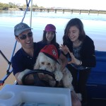 Ziggy the dog steers the boat